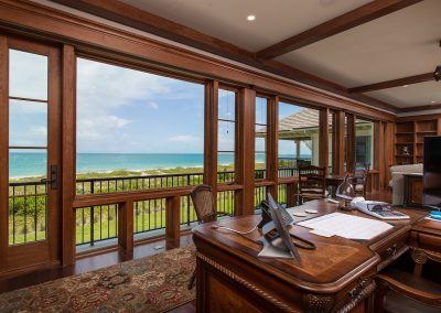 View of ocean through wood windows in office